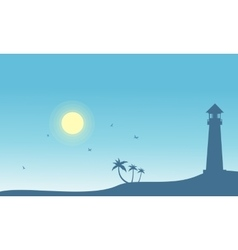 Silhouette of lighthouse and palm scenery vector image