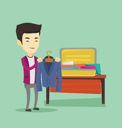 young man packing his suitcase vector image