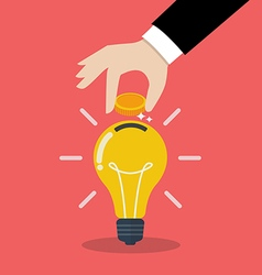 Hand inserting coin in light bulb vector image