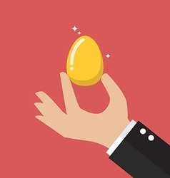 Hand with golden egg vector