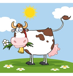 Dairy cow with flower in mouth on a meadow vector