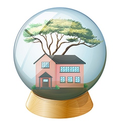 A pink house inside the crystal ball vector