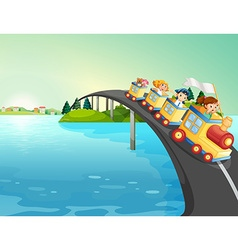 Children riding train over the bridge vector image