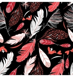 Feathers on a black background vector