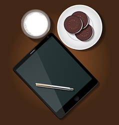 Tablet with milk and cookie vector