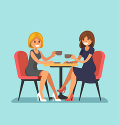 Two beautiful women sitting in a cafe vector