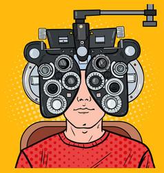 Pop art man at clinic with optical phoropter vector