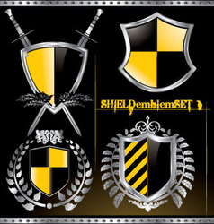 Glossy black and yellow shield emblem set vector