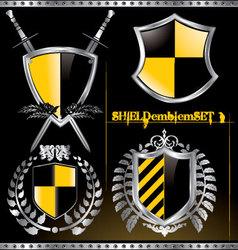 glossy black and yellow shield emblem set vector image vector image