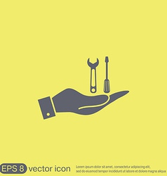 Hand holding a screwdriver and wrench symbol vector