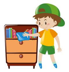 Boy cleaning shelf full of books vector