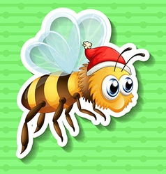 Sticker of bee wearing christmas hat vector