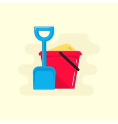 Bucket and spade with sand icon vector