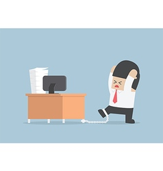 Businessman chained to the desk vector