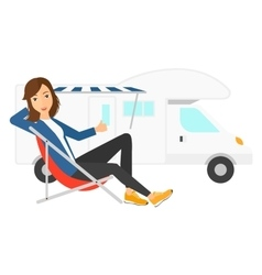 Woman sitting in front of motorhome vector image