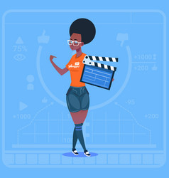 African american girl holding clapperboard modern vector