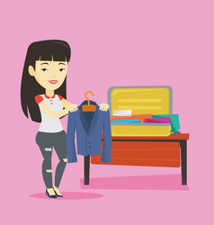 young woman packing suitcase vector image