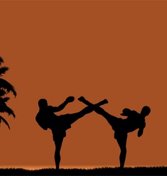 Two people engaged in martial arts on the beach vector