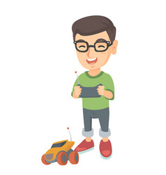 caucasian boy playing with a radio-controlled car vector image