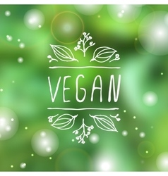 Vegan product label on blurred background vector