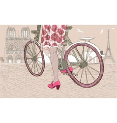 Woman riding a bike in paris vector