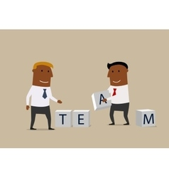 Two businessmen composing word Team from cubes vector image vector image