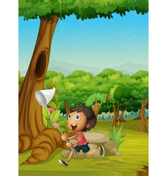 Boy running in a forest vector image vector image