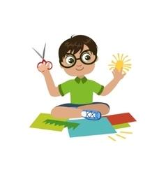 Boy in glasses preparing details for applique vector