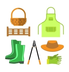 Blank apron and gardening tools isolated vector