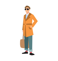 Elegant fashion man in cardigan and jeans vector