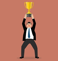 Businessman holding up a winning trophy vector