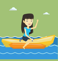 Tourists riding a banana boat vector