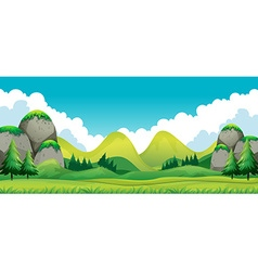Scene of green field with mountains background vector