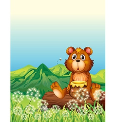 A bear sitting at the trunk vector image