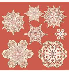 Paper cut golden snowflakes vector