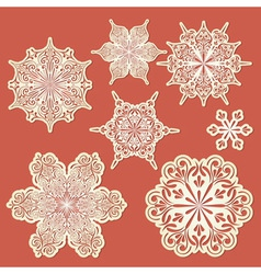 paper cut golden snowflakes vector image vector image