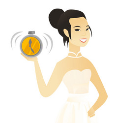 Young asian fiancee holding an alarm clock vector