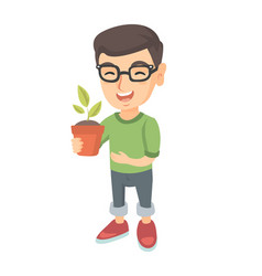 Caucasian smiling boy holding a potted plant vector
