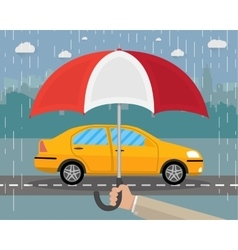 Hand with umbrella that protects car vector image vector image