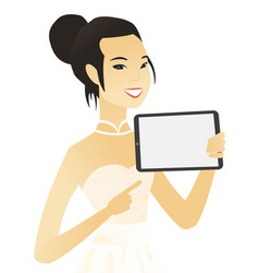Young asian fiancee holding tablet computer vector