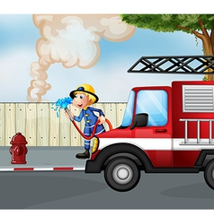A fireman rescuing a fire near the street vector image
