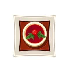 Borscht with a cherry tomato and basil leaves vector