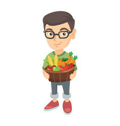 Boy holding basket with fruit and vegetables vector