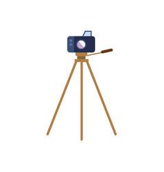 Flat lens photo camera standing at tripod vector