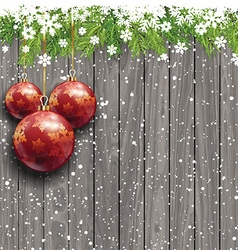 Christmas baubles on a wooden background vector image