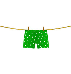 Boxer shorts with white hearts hanging on rope vector