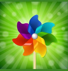 Green sunburst with colorful pinwheel vector