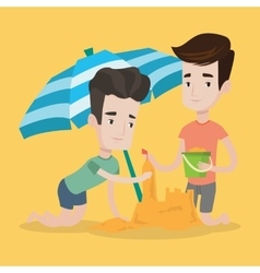 Male friends building sandcastle on beach vector