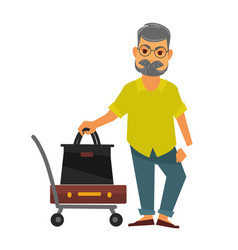 Senior man standing near travelling bags on cart vector