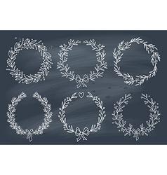 Set of winter wreaths on blackboard vector image vector image